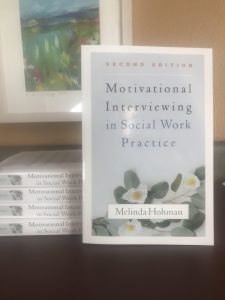 """""""Motivational Interviewing in Social Work Practice"""" book on a table"""
