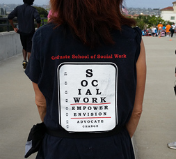 student wearing school of social work t-shirt